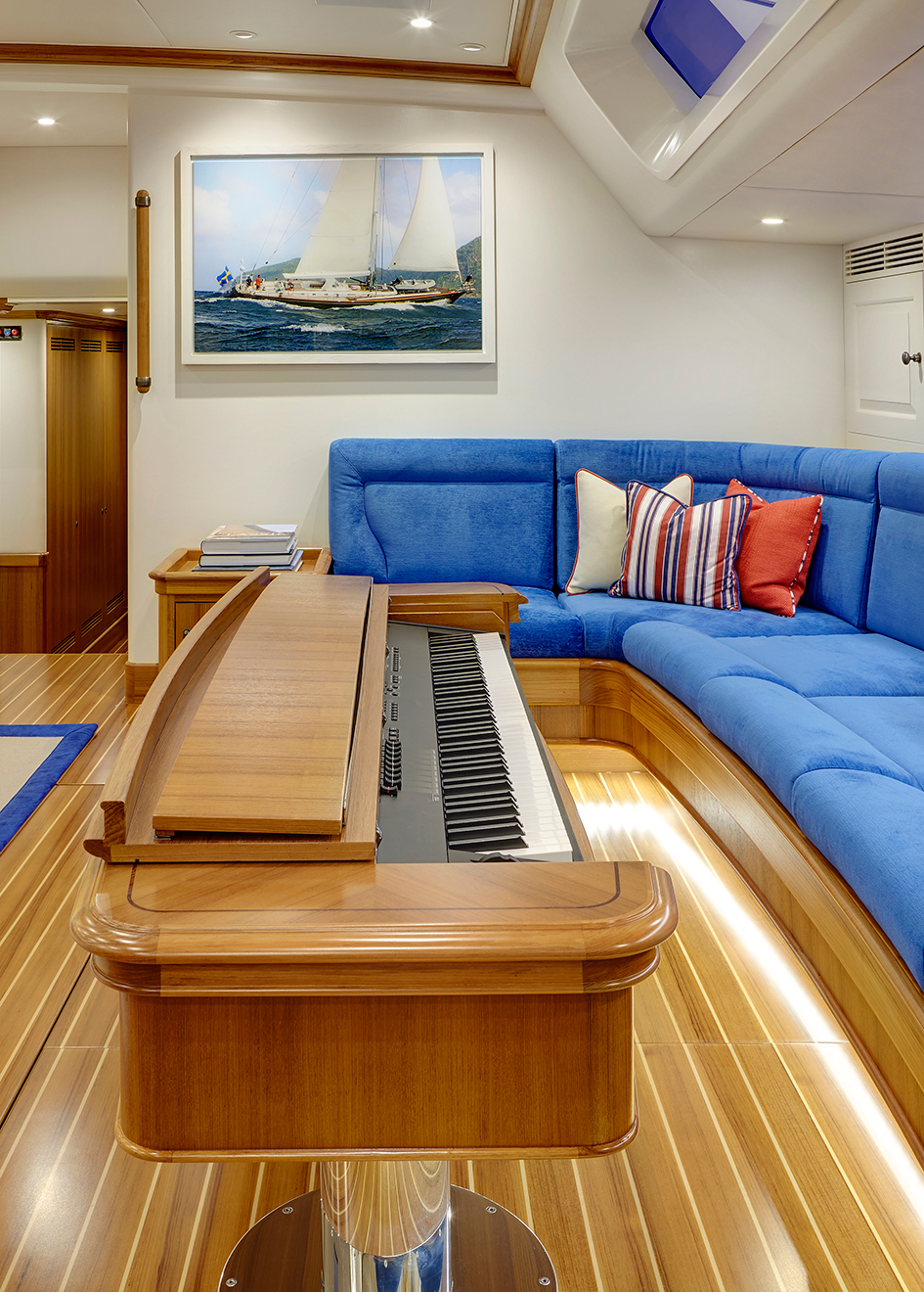 the-saloon-on-yachting-developments-sailing-super-yacht-cygnus-montanus-features-a-hidden-piano