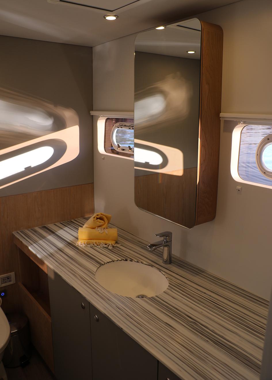 en-suite-on-open-ocean-800-expedition-catamaran-cake