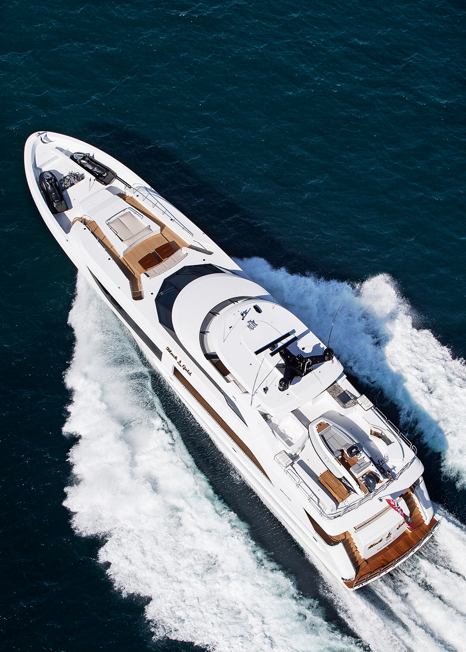 aerial-view-of-the-westport-125-yacht-black-gold