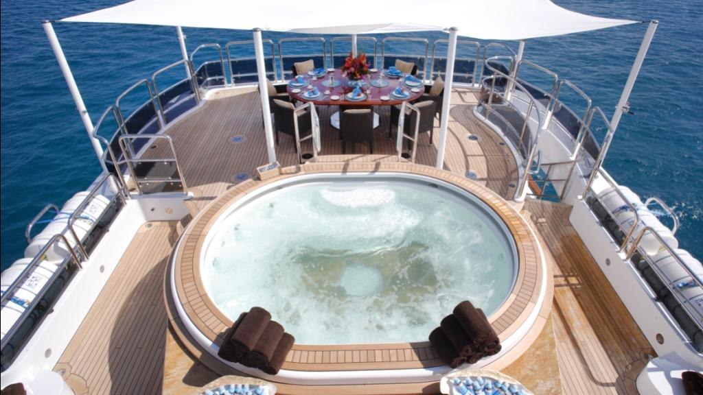 diamonds-are-forever-motor-yacht-benetti-2011-61m-deck-jacuzzi-dining-table