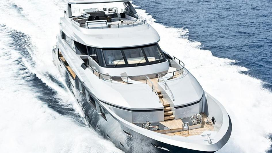 low-profile-motor-yacht-tecnomar-2014-40m-side-aerial-bow-cruising
